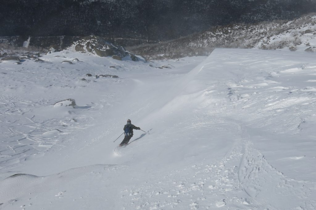 Graham shows me the soft snow at Thredbo, August 2018